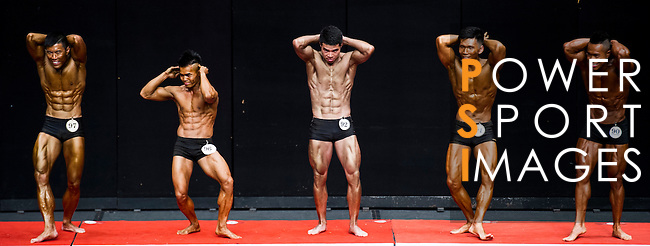 A bodybuilder competes in the South China Men's Athletic Physique below 170cm category during the 2016 Hong Kong Bodybuilding Championships on 12 June 2016 at Queen Elizabeth Stadium, Hong Kong, China. Photo by Lucas Schifres / Power Sport Images