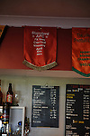 Stamford AFC 2 Marine 4, 29/03/2014. Wothorpe Road, Northern Premier League. A pennant is displayed on the bar from Stamfords 1979/80 FA Vase victory. The Northern Premier League game between Stamford AFC and Marine from The Daniels Stadium. Marine won the game 4-2 in front of 320 supporters to boost their chances of relegation survival. Stamford AFC are moving to the brand new Zeeco Stadium at the end of the 2013/14 season Photo by Simon Gill.