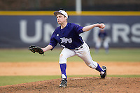 High Point Panthers relief pitcher Jeremy Johnson (14) delivers a pitch to the plate against the UNCG Spartans at Willard Stadium on February 14, 2015 in High Point, North Carolina.  The Panthers defeated the Spartans 12-2.  (Brian Westerholt/Four Seam Images)