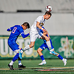 26 October 2019: University of Vermont Catamount Midfielder Jon Arnar Barðdal, a Senior from Garðabær, Iceland, heads the ball away from UMass Lowell River Hawk Backfielder German Fuentes, a Sophomore from Joroco, El Salvador, in the first half of NCAA Soccer play at Virtue Field in Burlington, Vermont. The Catamounts rallied to defeat the River Hawks 2-1, propelling the Cats to the America East Division 1 conference playoffs. Mandatory Credit: Ed Wolfstein Photo *** RAW (NEF) Image File Available ***