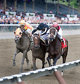 Remark (rail) outduels Arena Elvira (center) and  Super Espresso to wire.