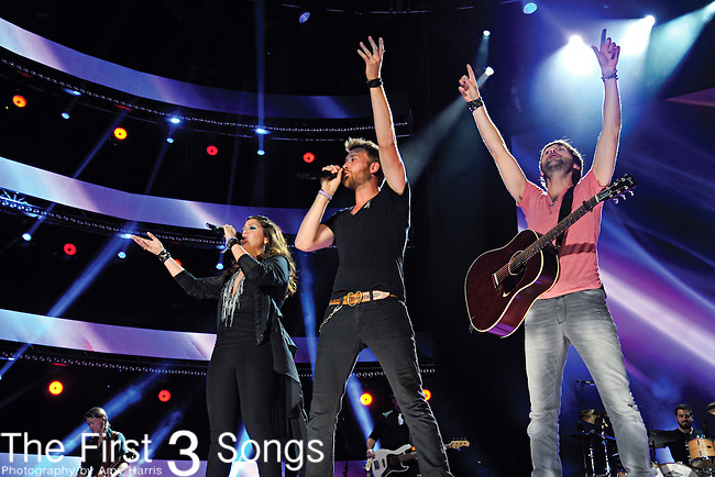 Hillary Scott, Charles Kelley, and Dave Haywood of Lady Antebellum perform at LP Field during the 2012 CMA Music Festival on June 07, 2011 in Nashville, Tennessee.