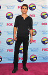 UNIVERSAL CITY, CA - JULY 22: Paul Wesley poses in the press room at the 2012 Teen Choice Awards at Gibson Amphitheatre on July 22, 2012 in Universal City, California.