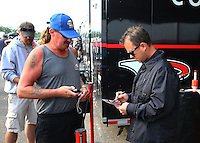 Aug. 18, 2013; Brainerd, MN, USA: NHRA top fuel dragster driver Steve Torrence signing an autograph during the Lucas Oil Nationals at Brainerd International Raceway. Mandatory Credit: Mark J. Rebilas-