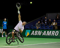 Rotterdam, The Netherlands. 15.02.2014. Stephane Houdet(FRA) in his match against Shingo Kunieda(JPN)at the ABN AMRO World Wheelchair tennis Tournament<br /> Photo:Tennisimages/Henk Koster