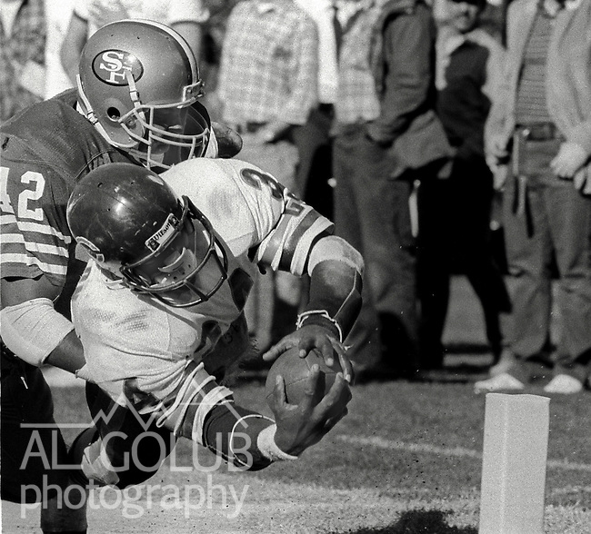 San Francisco 49ers vs. Chicago Bears at Candlestick Park Sunday, November 13, 1985..Bears beat the 49ers 26-10.San Francisco 49ers Defensive Back Ronnie Lott (42) tackles Chicago Bears Running Back Walter Payton (34) as he makes Bears touchdown...