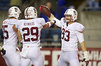 SEATTLE, WA - September 28, 2013: Stanford linebacker Trent Murphy, right, celebrates returning an interception for a touchdown with teammates safety Ed Reynolds, center and linebacker Jarek Lancaster against Washington State at CenturyLink Field. Stanford won 55-17