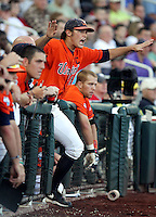 Virginia's Tyler Wilson signals a safe call from the dugout. South Carolina beat Virginia 3-2 in 13 innings at the College World Series on June 24, 2011 in Omaha, Neb. (Photo by Michelle Bishop)..
