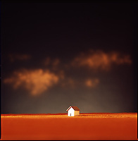 Small house on horizon