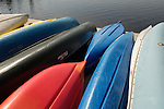 Multicolored design of canoes and kayaks.