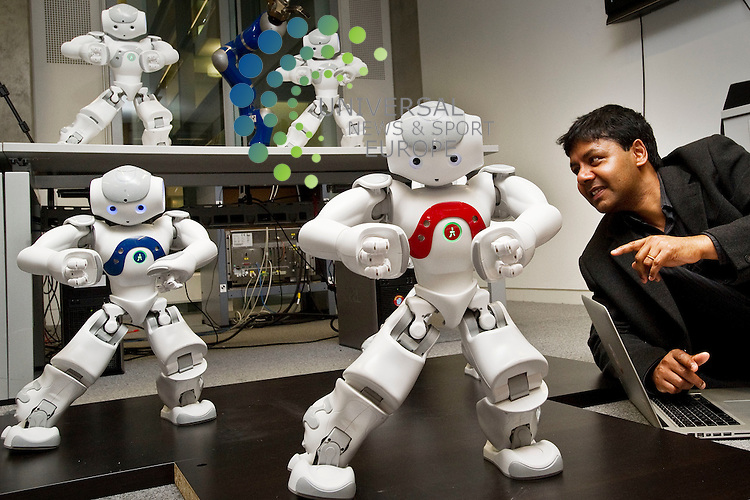 Professor Sethu Vijayakumar, Director of Institute of Perception, Action and Behaviour at the School of Informatics, University of Edinburgh with a mini robot dance troup that promises to be one of the hits of this year's Edinburgh International Festival, Edinburgh, Scotland, 3rd April, 2012.Picture:Scott Taylor Universal News And Sport (Europe) .All pictures must be credited to www.universalnewsandsport.com. (Office)0844 884 51 22.