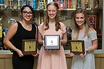 November 1, 2017- Tuscola, IL- Warrior Football Cheerleader award recipients. From left are Hannah Saril (Leadership), Caleigh Parsley (Most Improved), and Emma Zimmer (Warrior Spirit). [Photo: Douglas Cottle]