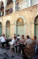 Libyan Arab Jamahiriya   .Tripoli       June 2002. The Medina. Men smoke the narghile.Libia Tripoli  Giugno 2002.La Medina.