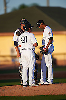 Lakeland Flying Tigers pitching coach Jorge Cordova (40) talks with pitcher Endrys Briceno  (45) and catcher Grayson Greiner (8) during a game against the Tampa Yankees on April 7, 2016 at Henley Field in Lakeland, Florida.  Tampa defeated Lakeland 9-2.  (Mike Janes/Four Seam Images)