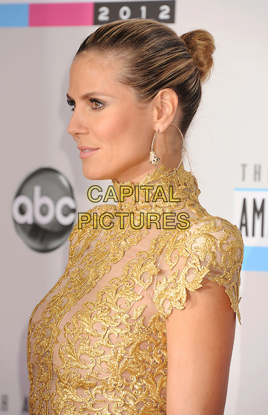 Heidi Klum.40th Anniversary American Music Awards - Arrivals held at Nokia Theatre L.A. Live, Los Angeles, California, USA..November 18th, 2012.AMA AMAs headshot portrait hoop earrings gold lace high collar shoulder pads profile .CAP/ROT/TM.©Tony Michaels/Roth Stock/Capital Pictures