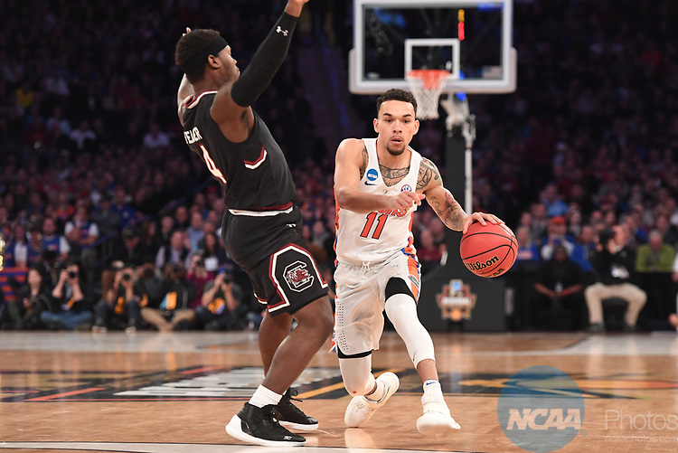 NEW YORK, NY - MARCH 26:  Chris Chiozza #11 of the Florida Gators is guarded by Rakym Felder #4 of the South Carolina Gamecocks during the 2017 NCAA Men's Basketball Tournament held at Madison Square Garden on March 26, 2017 in New York City. (Photo by Justin Tafoya/NCAA Photos via Getty Images)
