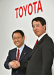 May 13, 2015, Tokyo, Japan - Presidents Akio Toyoda, left, of Toyota Motor Corp., and Masamichi Kogai of Mazda Motor Corp. shake hands during a news conference at a Tokyo hotel on Wednesday, May 13, 20-15. Japans two automakers announced long-term partnership in technology in which Toyota will provide its fuel cell and plug-in hybrid technology in return for Mazda's proprietary Skyactive green technology. (Photo by Natsuki Sakai/AFLO)