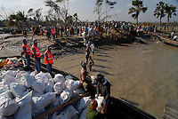 BANGLADESH District Bagerhat , cyclone Sidr and high tide destroy villages in Southkhali at river Balaswar , distribution of relief goods in bags with the printing: Saudi Arabia the kingdom of humanity  / BANGLADESCH, der Wirbelsturm Zyklon Sidr und eine Sturmflut zerstoeren Doerfer im Kuestengebiet von South Khali , Verteilung von Hilfsguetern aus Saudi-Arabien