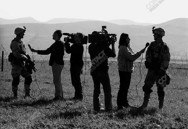 US soldiers from the 173rd Airborne give interviews to the press at the beginning of the US invasion of Iraq, northern Iraq, April 2003.