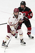 Delaney Belinskas (BC - 17), Paige Capistran (NU - 12) -  The Boston College Eagles defeated the Northeastern University Huskies 2-1 in overtime to win the 2017 Hockey East championship on Sunday, March 5, 2017, at Walter Brown Arena in Boston, Massachusetts.