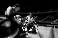 Cristian Amaya and Moises Alonso, Colombian disabled athletes, in action during a wheelchair rugby training match at the indoor sporting arena Coliseo in Bogota, Colombia, 11 April 2013. Wheelchair rugby, a full-contact team sport, was developed in Canada in 1977 under the name murderball. The game is played only by athletes with some form of disability in both the upper and lower limbs (quadriplegics). Attempting to score by carrying the ball across the goal line, four players from each team roughly crash into each other in specially designed armored wheelchairs. Although the team from Bogota is supported by a foundation (gear), quad rugby players, mostly coming from the remote, socially deprived neighbourhoods, often can not attend a training due to lack of funds for transportation. However, they still dream of representing Colombia at Rio 2016 Paralympic Games.