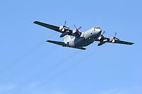 Missouri Air National Guard C-130H Hercules assigned to the 139th Airlift Wing (AMC) located at Rosecrans Air National Guard Base in Saint Joseph, Missouri, flies through blue skies.