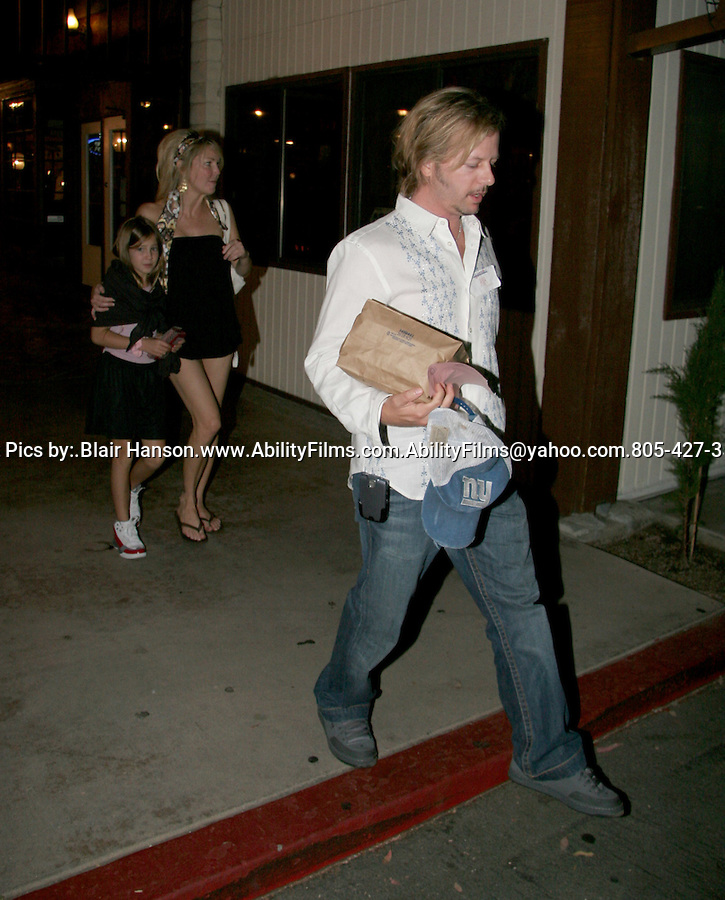 Exclusive Heather Locklear with kid and David Spade eating at a restaurant in Agoura Hills at 9 P.M. They were very happy and having a great time inside.. David spade met Heather at the restaurant and left in seperate cars