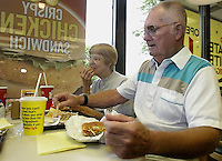 Ward, right, and Kaye Hunlock, of Lima, enjoy chicken nuggets and french fries at a Wendy's restaurant Wednesday, June 7, 2006, in Dublin, Ohio. Wendy's is making the switch to non-hydrogenated cooking oil for fries and breaded chicken products.<br />