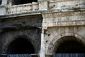 Close-up of the remaining exterior outer wall of the Colosseum, also known as the Flavian Amphitheatre showing the dirty, unrestored Tuscan architecture on the left, and the cleaned and restored Tuscan architecture on the right, in Rome, Italy on Friday, May 25, 2012.  The gate entrance number can be clearly seen over the arch at right..Credit: Ron Sachs / CNP