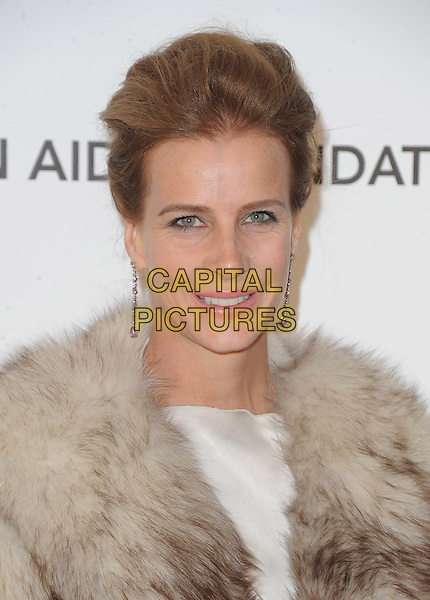 Rachel Griffiths.The 21st Annual Elton John AIDS Foundation Academy Awards Viewing Party held at The City of West Hollywood Park in West Hollywood, California, USA..February 24th, 2013.oscars headshot portrait smiling dangling earrings beige cream silk satin brown fur wrap .CAP/DVS.©DVS/Capital Pictures.