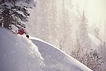 A man skiing powder snow.