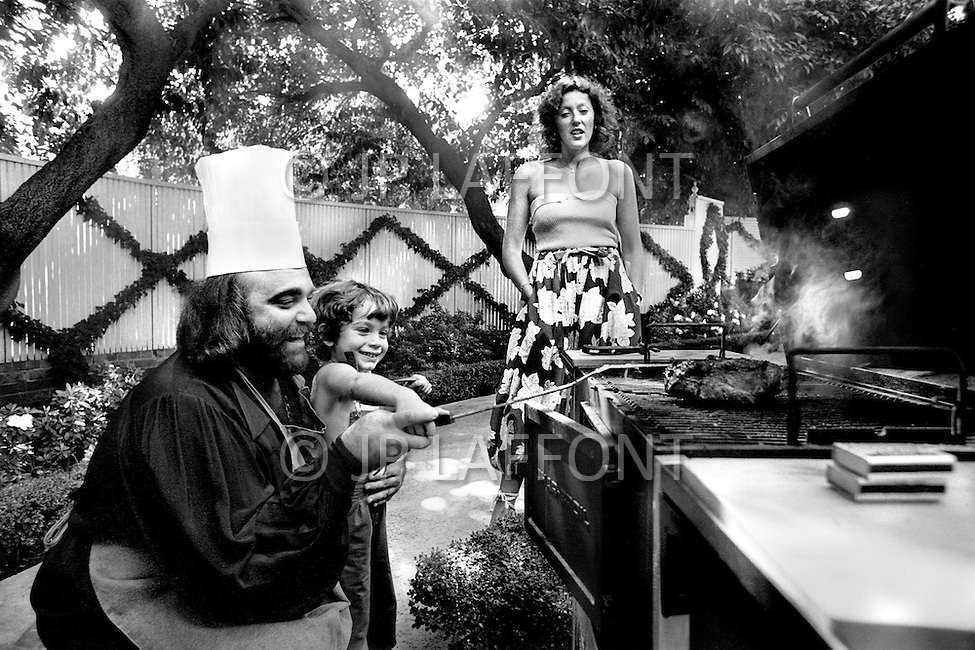 Beverly Hills, California. October 1979. Demis Roussos and his wife Dominique and one of their child, the five years old Cyril. Demis love to be the family BBQ chef. Their home was situated in the legendary Rodeo Drive.