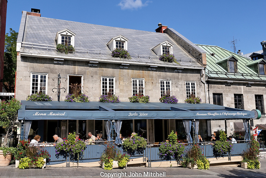 People dining in the Jardin Nelson, a French restaurant on Place Jacques Cartier in Old Montreal, Quebec, Canada