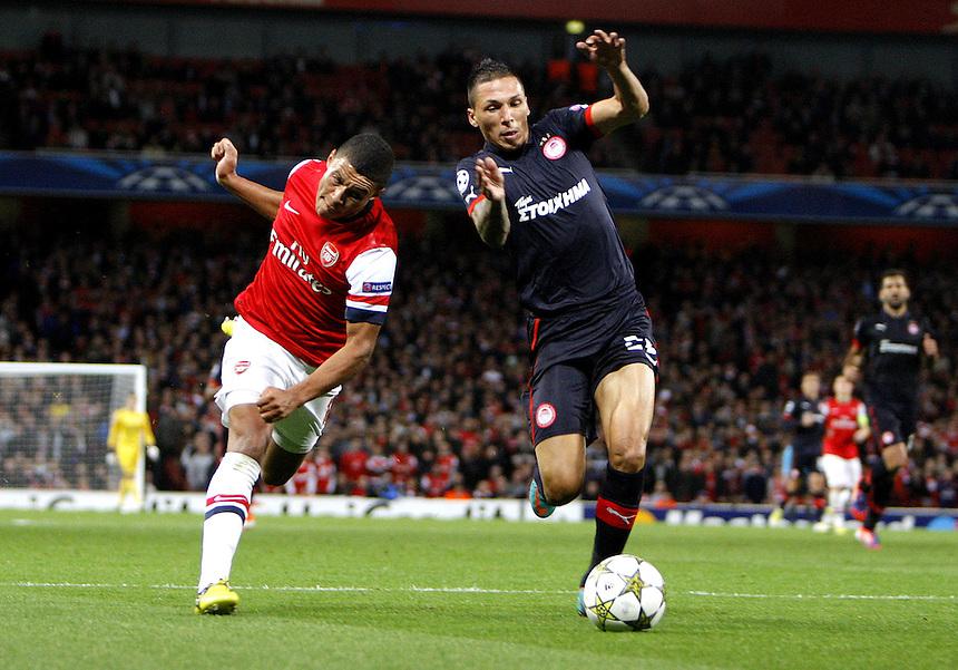 Arsenal's Alex Oxlade-Chamberlain battles with Olympiakos' Giannis Maniatis ..Football - UEFA Champions League Group B - Arsenal v Olympiakos FC - Wednesday 3rd October 2012 - Emirates Stadium - London..