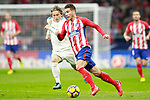 Atletico de Madrid's Lucas Hernandez (r) and Real Madrid CF's Luka Modric during La Liga match. November 18,2017. (ALTERPHOTOS/Acero)