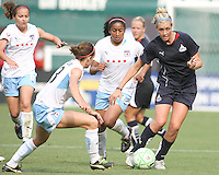 Allie Long #9 of the Washington Freedom faces a tackle from Natalie Spillger #13 of the Chicago Red Stars during a WPS match at RFK stadium on June 13 2009 in Washington D.C. The game ended in a 0-0 tie.