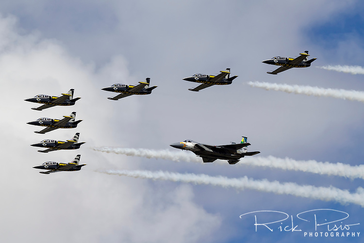 An Oregon Air National Guard F-15 Eagle fighter of the 173rd Fighter Wing flies in formation with seven Aero L-39 Albatros trainers of the Breitling Jet Team during an airshow in Hillsboro, Oregon, in August of 2016