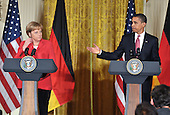 Washington, D.C. - June 26, 2009 -- United States President Barack Obama and Chancellor Angela Merkel of Germany hold a joint press conference in the East Room of the White House in Washington, D.C. on Friday, June 26, 2009..Credit: Ron Sachs / CNP