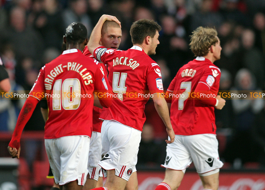 Michael Morrison of Charlton Athletic is congratulated by team mates after scoring the opening goal - Charlton Athletic vs Brentford - nPower League One Football at The Valley, London - 02/01/12 - MANDATORY CREDIT: Helen Watson/TGSPHOTO - Self billing applies where appropriate - 0845 094 6026 - contact@tgsphoto.co.uk - NO UNPAID USE.