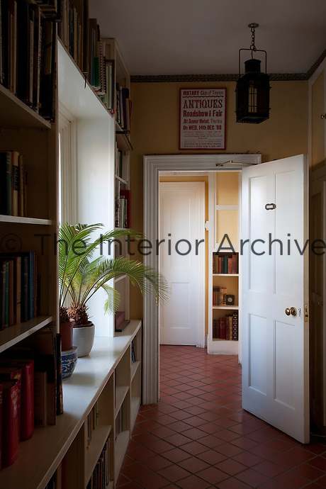 A corridor in the private wing of the castle is lined with built-in bookcases