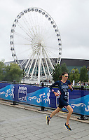 10 AUG 2014 - LIVERPOOL, GBR - Gwen Jorgensen (USA) from the USA starts her run during the elite women's race at the Tri Liverpool triathlon in Kings Dock, Liverpool, Great Britain (PHOTO COPYRIGHT © 2014 NIGEL FARROW, ALL RIGHTS RESERVED)