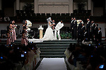 Guest take photographs as Aaron Ross double checks his bride after removing Sanya Richards vail. Olympic gold medalist, Sanya Richards, and New York Giants cornerback, Aaron Ross, wed at the Hyde Park Baptist in Austin, Texas on Friday, February 26, 2010...