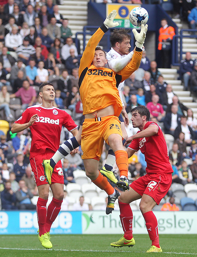 Crawley Town's Jamie Ashdown battles for an aerial ball with Preston North End's Joe Garner<br /> Photographer Rich Linley/CameraSport<br /> <br /> Football - The Football League Sky Bet League One - Preston North End v Crawley Town - Saturday 20th September 2014 - Deepdale - Preston<br /> <br /> &copy; CameraSport - 43 Linden Ave. Countesthorpe. Leicester. England. LE8 5PG - Tel: +44 (0) 116 277 4147 - admin@camerasport.com - www.camerasport.com