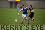 Con Barrett of Kerins O'Rahillys and John Payne of  Dr Crokes racing for possession in the last round game of the Senior Club Championship in Strand Road on Saturday evening.