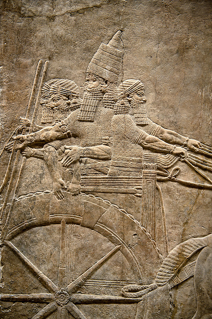 Assyrian relief sculpture panel of Ashurnasirpal on his chariot at the begining of a lion hunt.  From Nineveh  North Palace, Iraq,  668-627 B.C.  British Museum Assyrian  Archaeological exhibit no ME 124858