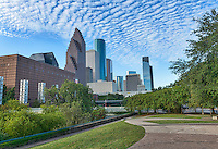 "Houston skyline from Sesquicentennial Park in downtown Houston. It was one of those morning with beaufiful blue sky and wonderful clouds in the sky to create this nice cityscape of the city. The Sesquicentennial park was established in 1989 along the banks of the Buffalo Bayou along the Theater District.  The park is an 22.5 acrea urban park and was  officially establish in 1986 to commemorate the 150 year anniversary of the founding of the city of Houston.  The park was was done in two phases and was officially finished in 1998.  The park features ""Seven Wonders"", a set of seven pillars illuminated from within by Houston native Mel Chin along with other sculptures and statues done by local artist along with a statue of George H W Bush our 41 president can be seen looking at the city skyline."