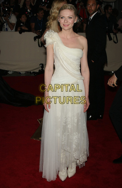 "KIRSTEN DUNST .attending the Metropolitan Museum of Art's Costume Institute Gala ""American Woman: Fashioning A National Identity"" held at the Metropolitan Museum of Art, New York, NY, USA, May 3rd, 2010.. arrivals full length white cream one shoulder long maxi dress   lace tulle pointy shoes        boots                                        CAP/LNC/TOM.©LNC/Capital Pictures."
