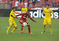 July 27, 2013: Toronto FC midfielder Reggie Lambe #19 battles with Columbus Crew midfielder Wil Trapp #20 and Columbus Crew midfielder Matias Sanchez #8 during an MLS regular season game between the Columbus Crew and Toronto FC at BMO Field in Toronto, Ontario Canada.<br /> Toronto FC won 2-1.