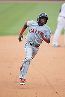 Jose Vinicio (3) of the Salem Red Sox hustles towards third base against the Winston-Salem Dash at BB&T Ballpark on May 31, 2015 in Winston-Salem, North Carolina.  The Red Sox defeated the Dash 6-5.  (Brian Westerholt/Four Seam Images)