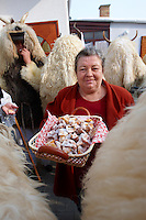 Women offering food to the Buso's on the Monady house visits of  the Busojaras Spring  festival 2010 Mohacs Hungary - Stock photos